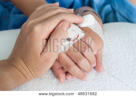 Holding Patient Boy Hand With Saline Intravenous (iv) In Hospital, Showing Care And Love From Mother
