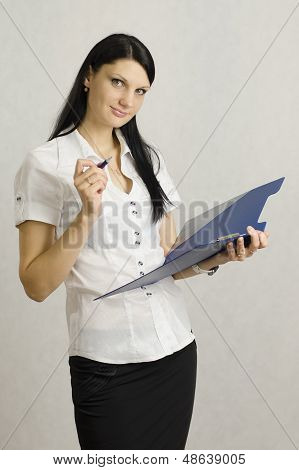 Business girl listens and makes notes