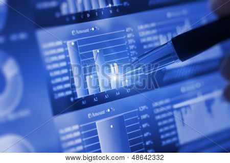 Analyzing stock market from computer screen.