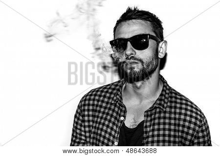 man smoking cigarette black and white portrait