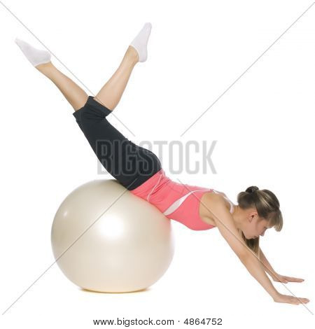 Fitness Girl Doing Pilates With A Ball