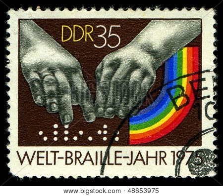 Ddr- Circa 1975: A Stamp Printed In Ddr, Shows  Hands Reading A Font Of Braille , Circa 1975
