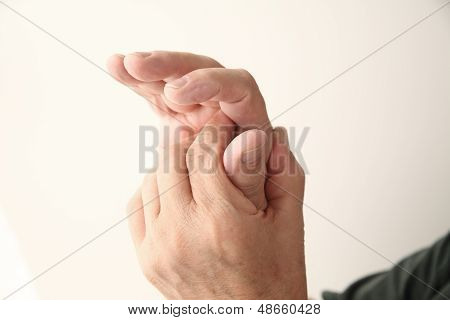 thumb pain in senior man