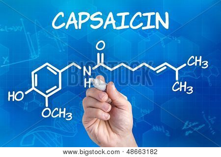 hand with pen drawing the chemical formula of capsaicin