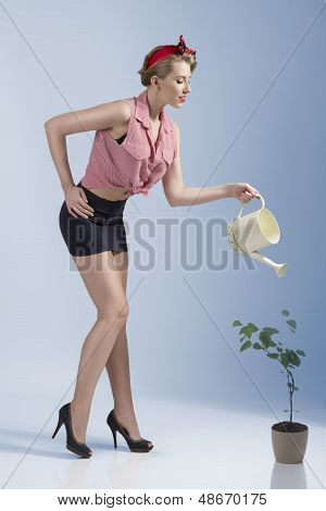Sensual Female Gardener In Summer Time