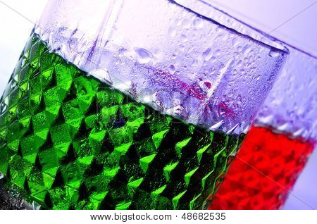 closeup of some glasses with beverages of different colors in a club