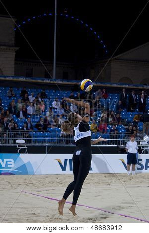 10/08/2011 LONDON, ENGLAND,  Zara Dampney (GBR) serves  during the FIVB International Beach Volleyball tournament, at Horse Guards Parade, Westminster, London.