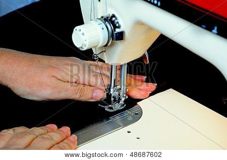 Using a domestic sewing machine.