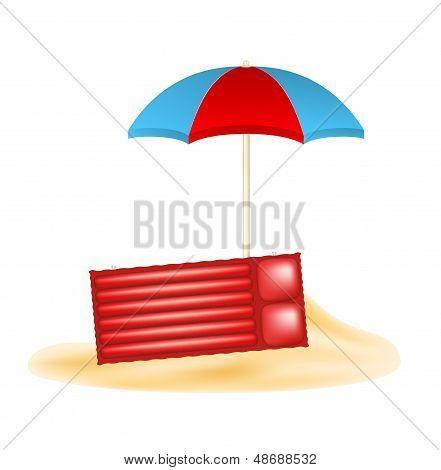 Beach umbrella and air mattress in sand