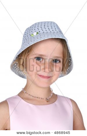 Young Girl In Cute Bucket Style Hat And Pink Dress