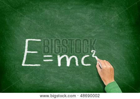 E=mc�² physics science formula equation blackboard. EMC2 written on chalkboard by science teacher or student in class.