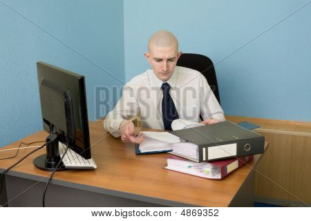 Bookkeeper On A Workplace At Office