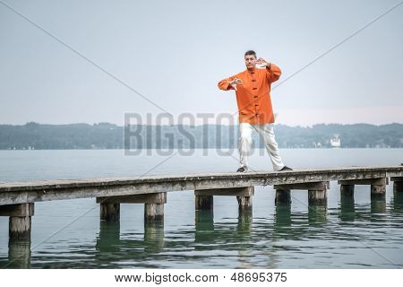 A man doing Qi-Gong in the early morning at the lake Starnberg