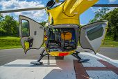 foto of medevac  - Paramedics helicopter prepared to upload patient with back doors open - JPG
