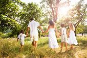 picture of father time  - Happy young family spending time outdoor on a summer day - JPG