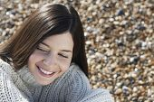 pic of herne bay beach  - Closeup of beautiful young woman smiling while looking away at beach - JPG