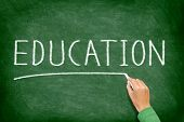 Education. School, teaching and educational concept blackboard. Hand writing EDUCATION on green chal