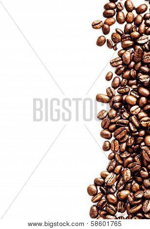 Brown Roasted Coffee Beans Isolated On White Background.  Arabic Roasting Coffee Ingredient Of Hot B