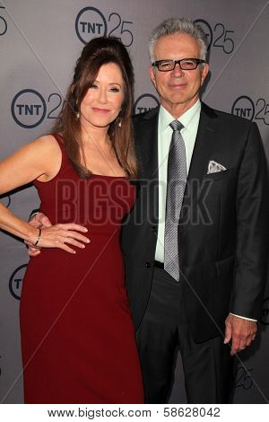 Mary McDonnell and Tony Denison at the TNT 25th Anniversary Party, Beverly Hilton Hotel, Beverly Hills, CA 07-24-13