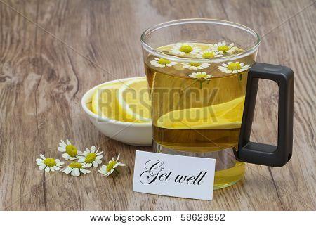 Get well card, chamomile tea and fresh lemon