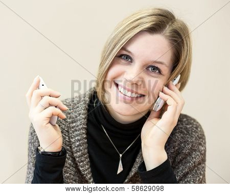 Happy Woman Calling With Two Mobile Phones