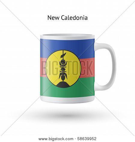 New Caledonia flag souvenir mug on white background.