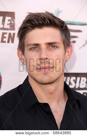 Chris Lowell at the Invisible Children Fourth Estate's Founders Party, UCLA, Westwood, CA 08-10-13