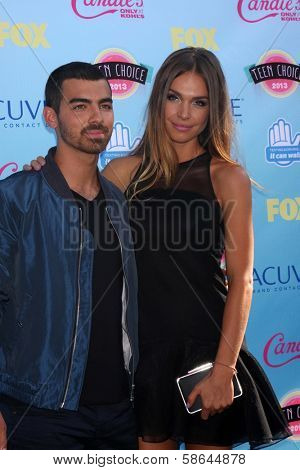 Joe Jonas and Blanda Eggenschwiler at the 2013 Teen Choice Awards Arrivals, Gibson Amphitheatre, Universal City, CA 08-11-13