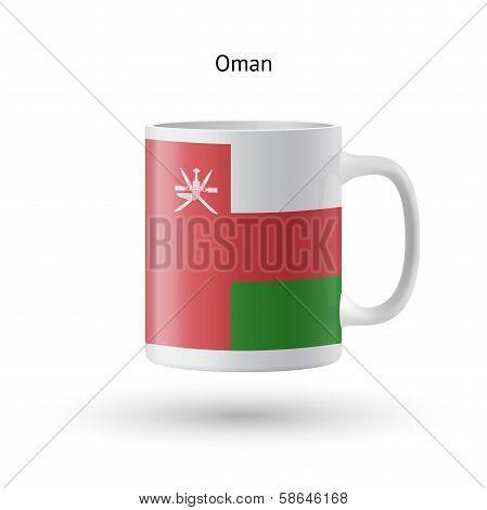 Oman flag souvenir mug on white background.