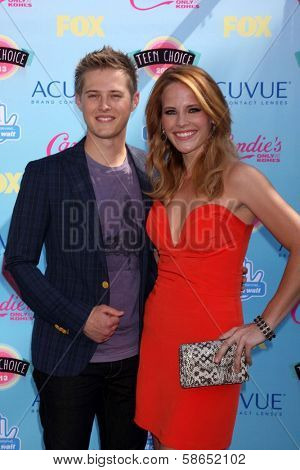 Lucas Grabeel and Katie Leclerc at the 2013 Teen Choice Awards Arrivals, Gibson Amphitheatre, Universal City, CA 08-11-13