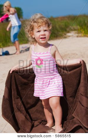 Beautiful Baby Girl On The Beach