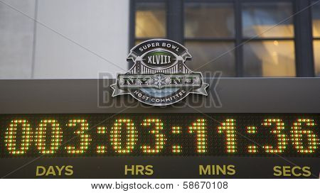 Super Bowl XLVIII NY NJ Host Committee logo on the clock counting time till Super Bowl XLVIII match