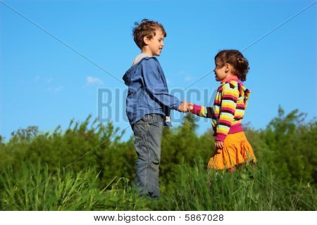 kids at green meadow holding hands