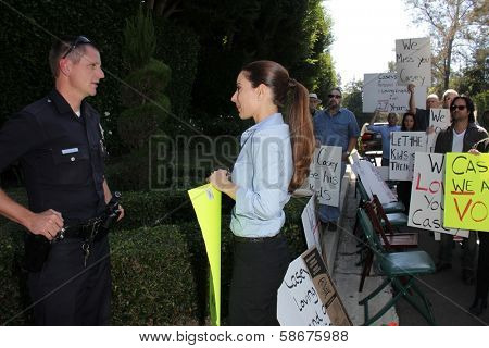 Kerri Kasem talks to the police at a protest involving Casey Kasem's children, brother and friends who want to see him but have been denied any contact,  Private Location, Holmby Hills, CA 10-01-13