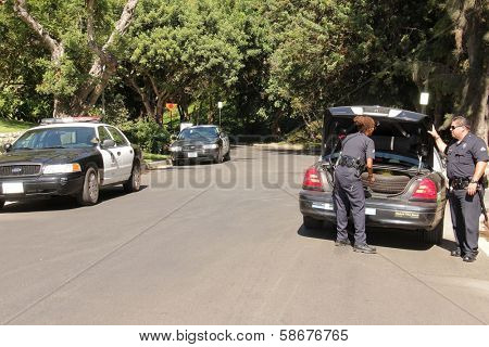 Police officers at a protest involving Casey Kasem's children, brother and friends who want to see him but have been denied any contact,  Private Location, Holmby Hills, CA 10-01-13