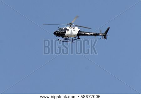 Police helicopter at a protest involving Casey Kasem's children, brother and friends who want to see him but have been denied any contact,  Private Location, Holmby Hills, CA 10-01-13