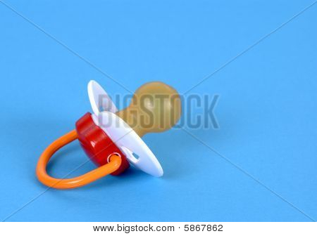 Pacifier On A Blue