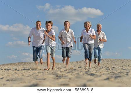 family  running barefoot