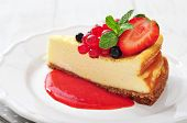 picture of cheesecake  - Cheesecake with fresh berries and mint on plate closeup - JPG