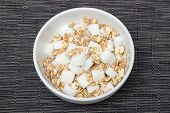 stock photo of diabetes mellitus  - A bowl of cereals with too much sugar - JPG