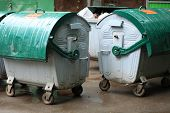 stock photo of dustbin  - image of two green dustbin at rain - JPG