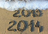 pic of happy new year 2013  - Happy New Year 2014 replace 2013 concept on the sea beach - JPG
