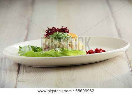 Salty Fish Salad On White Plate