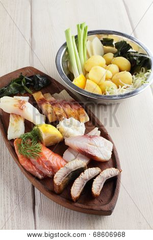 Salty Fish Assorti With Potato On Wooden Plate