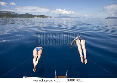 Greece, , Mediterranean Sea. The Synchronous Jumps In The Sea From The Yacht.