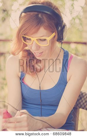 Beautiful Hipster Girl With Big Headphones Listening To The Music