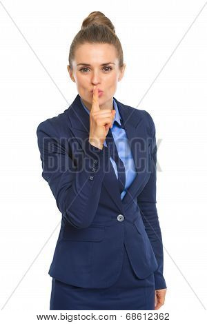 Business Woman Showing Shh Gesture