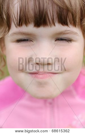 Close Up Of Face Little Beautiful Happy Grimacing Girl In Pink