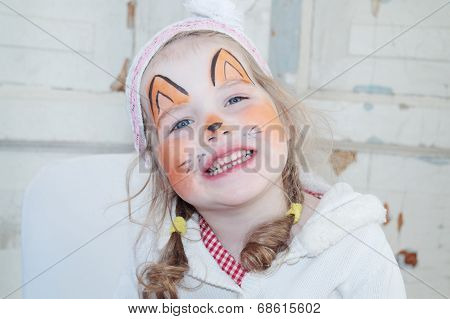 Little Beautiful Girl With Face Painting Of Fox Unnatural Smiles
