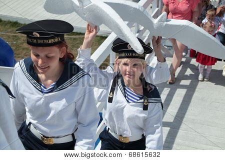 Perm, Russia - Jun 15, 2013: Girls In Suits Of Sailors Carry White Gulls. Million People Visited Fes